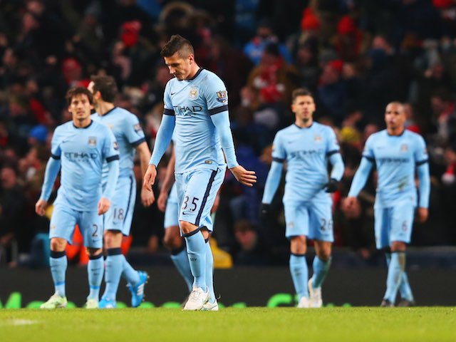 MANCHESTER, ENGLAND - JANUARY 18:  Stevan Jovetic (35) looks dejected alongside team mates during the Barclays Premier League match between Manchester City and Arsenal at Etihad Stadium on January 18, 2015 in Manchester, England.  (Photo by Alex Livesey/Getty Images)