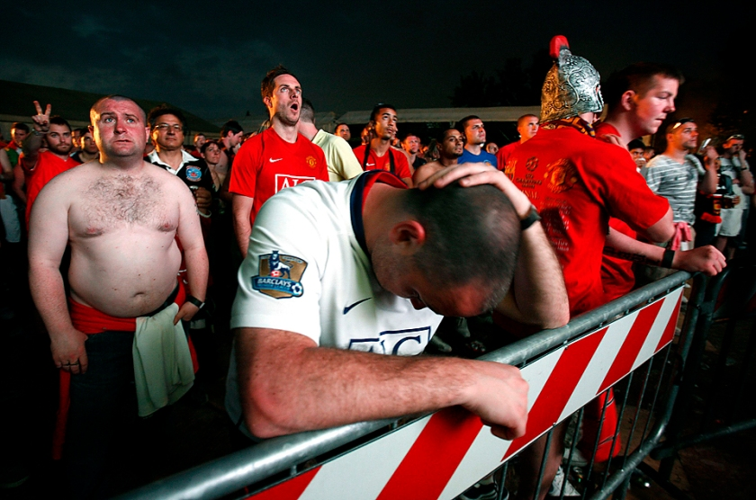 Manchester United's supporters react as they watch Champions League final soccer match between Manchester United and Barcelona in Rome