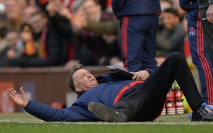 Manchester United's Dutch manager Louis van Gaal falls over on the touchline during the English Premier League football match between Manchester United and Arsenal at Old Trafford in Manchester in north west England on February 28, 2016. / AFP / OLI SCARFF / RESTRICTED TO EDITORIAL USE. No use with unauthorized audio, video, data, fixture lists, club/league logos or 'live' services. Online in-match use limited to 75 images, no video emulation. No use in betting, games or single club/league/player publications.  / OLI SCARFF/AFP/Getty Images
