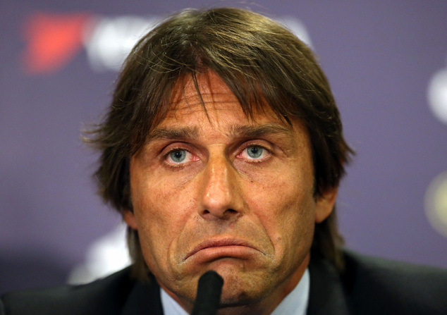 Chelsea's new manager Antonio Conte listens to a question during a press conference at Stamford Bridge, London, Thursday, July 14, 2016. Conte was appointed Chelsea boss on April 4 and takes up his role after leading Italy at Euro 2016, where they suffered a penalty shootout loss to Germany in the quarter-finals. (Steve Paston/PA via AP)